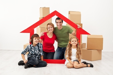 19505419 - happy family with kids moving into a new home - sitting with cardboard boxes